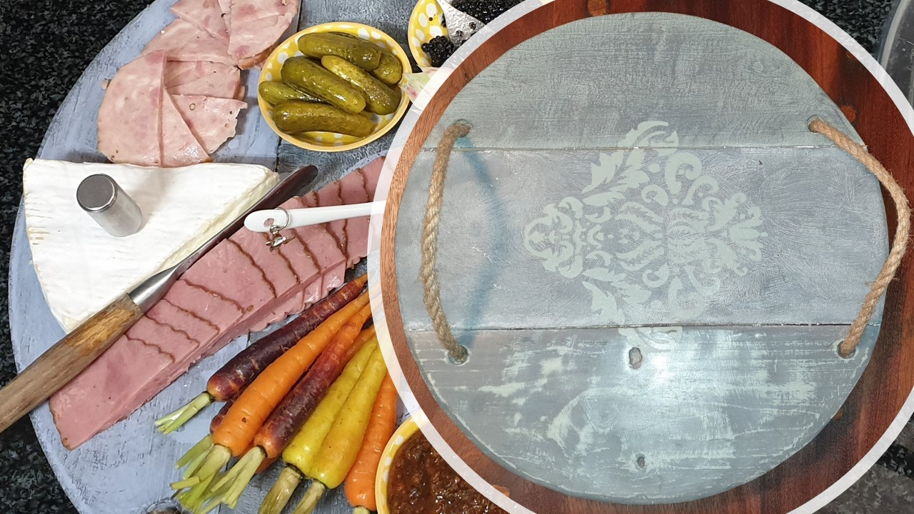 A serving platter my wife made. The base is reclaimed pine, and the platter was custom made for chalk painting. The starters were delicious, by the way.